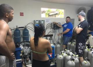 Students receive on-site compressor training at Smithsonian Research Station in Bocas del Toro, Panama
