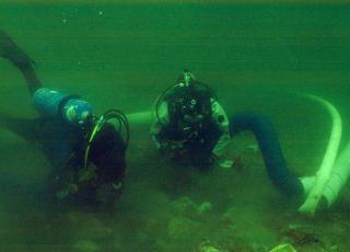 Divers excavate an archaeological site