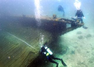 Scientific Diving Students measure a shipwreck